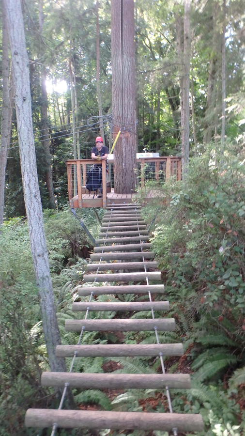 log suspension bridge with the guide at the other end