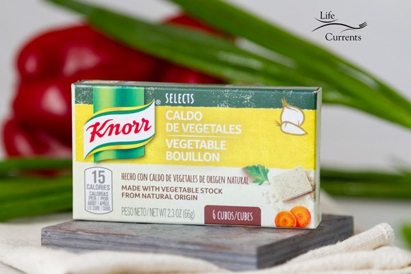 A box of Knorr Selects Bouillon Cubes with a red pepper and green onions in the background