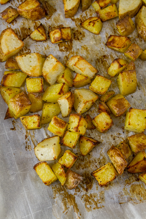 Sheet Pan Roasted Potatoes on a parchment paper