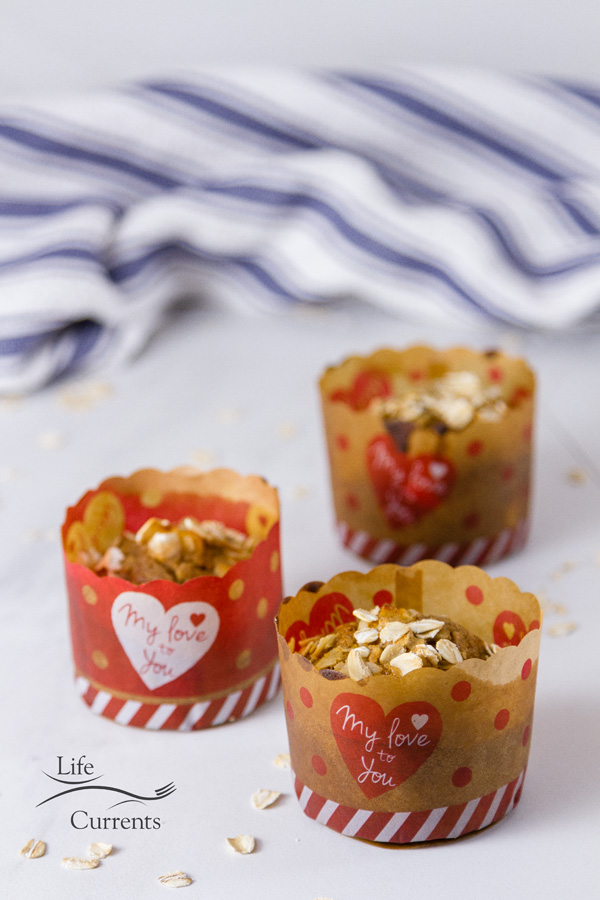 apple oatmeal muffins in Valentine's Day paper cups with a blue striped cloth in the background