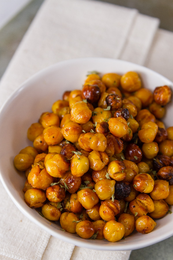 Buffalo Roasted Chickpeas in a white bowl on a white napkin