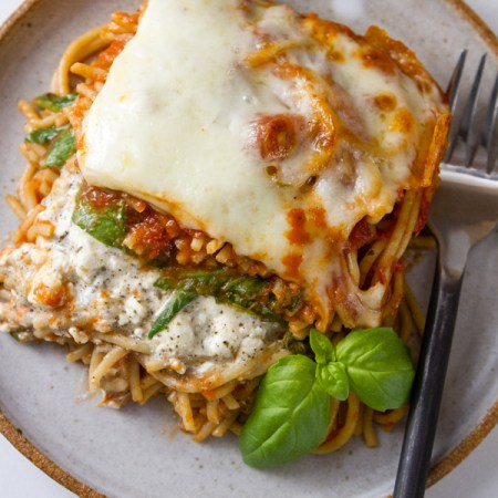 Spinach Provolone Baked Pasta top down looking at the plate with a serving on it and a fork