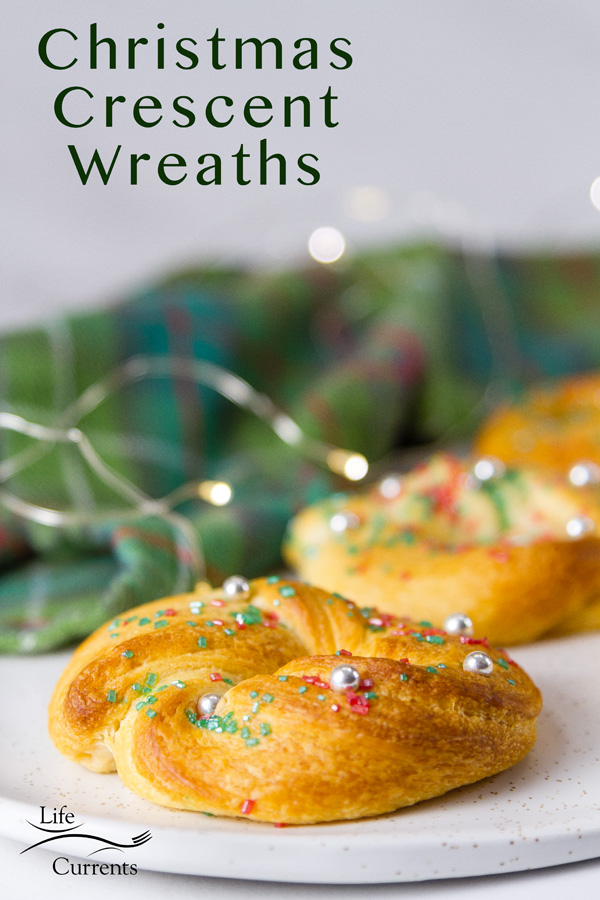 Christmas Crescent Wreaths title image with a tartan and Christmas lights