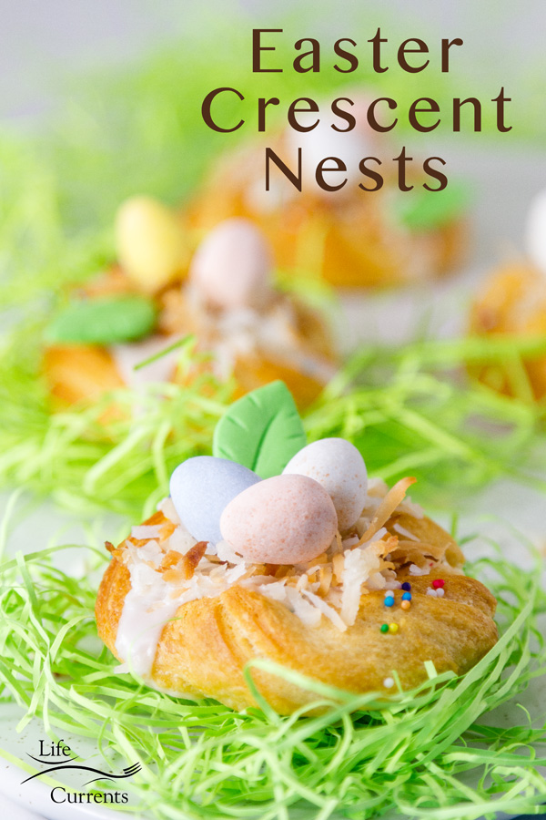 Easter Crescent Nests filled with lemon icing, coconut, and chocolate Easter eggs on bright green Easter grass with the title