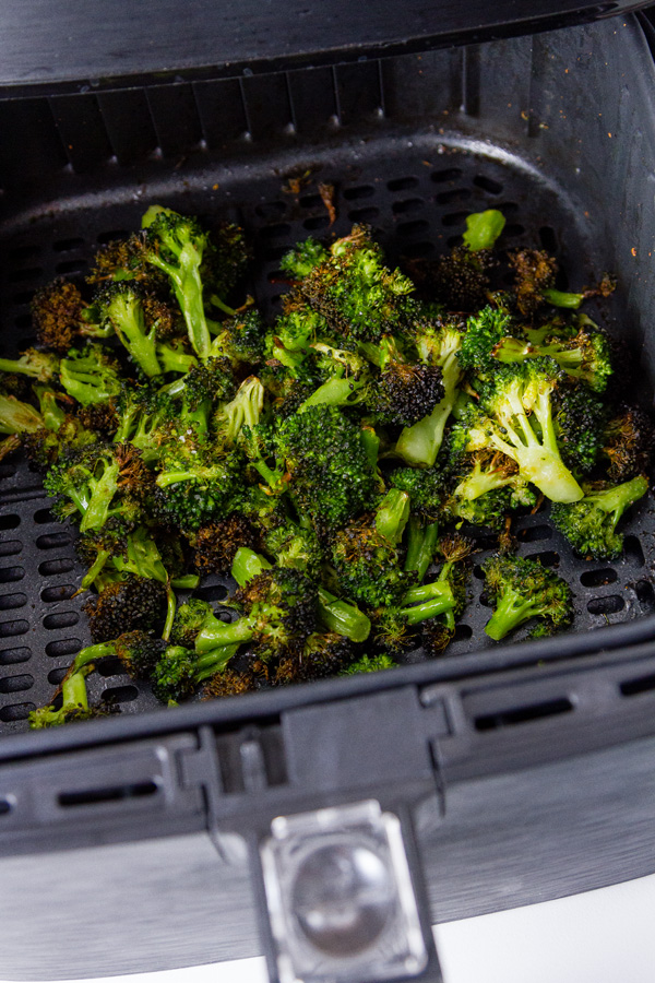 Air Fryer Roasted Broccoli in the basket of the air fryer after cooking
