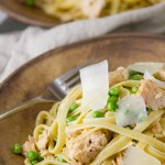 Two brown bowls filled with Easy Weeknight Tuna Pasta Dinner and topped with Parmesan, with a fork in the bowl