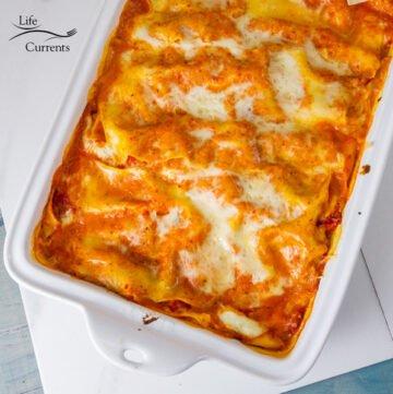 Sqare crop of Red Pepper Lasagna in a white pan