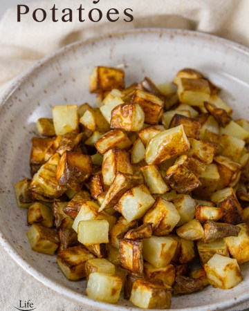 Air Fryer Potatoes in a white bowl with the title