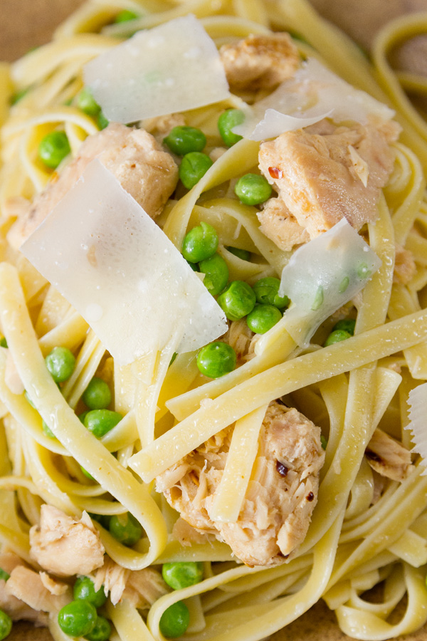 close up of Easy Weeknight Tuna Pasta Dinner with peas, parmesan, pasta, and tuna