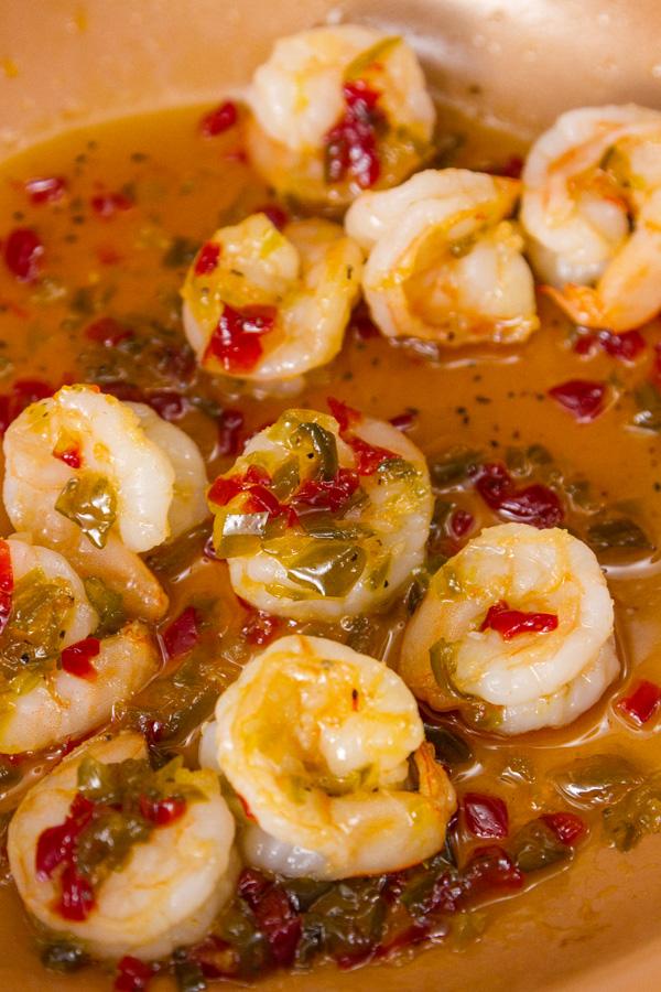shrimp and sauce in an orange pan