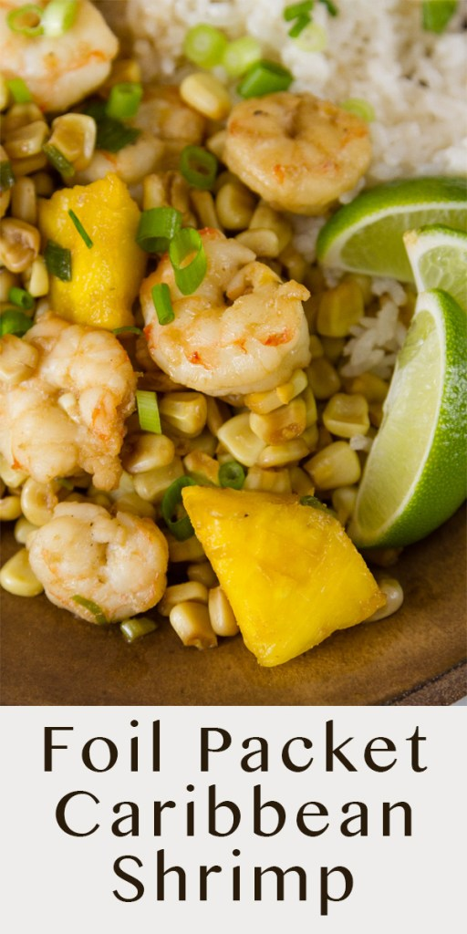 close up on shrimp, corn, and pineapple with lime wedges served over coconut rice. Title on lower portion: Foil Packet Caribbean Shrimp