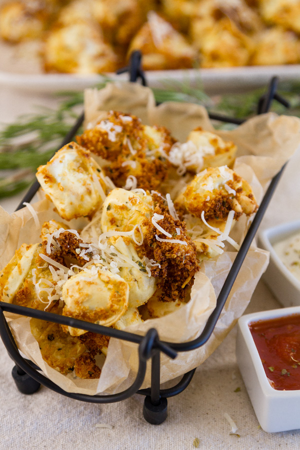 Crispy Tortellini served in an appetizer basket with dipping sauces