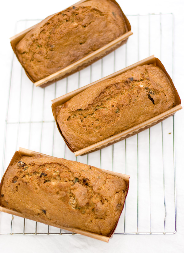 three loaves of bread baked in paper pans so they are ready to give as gifts