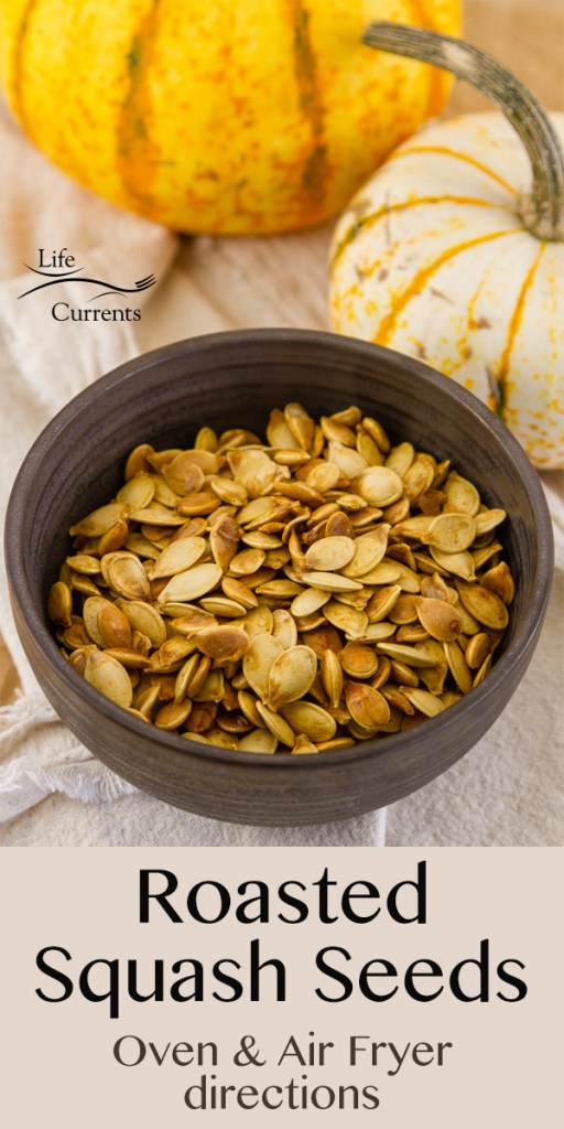 a dark bowl filled with roasted squash seeds and two small pumpkins in the background. Title on image