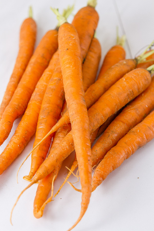 long skinny carrots with their tops taken off