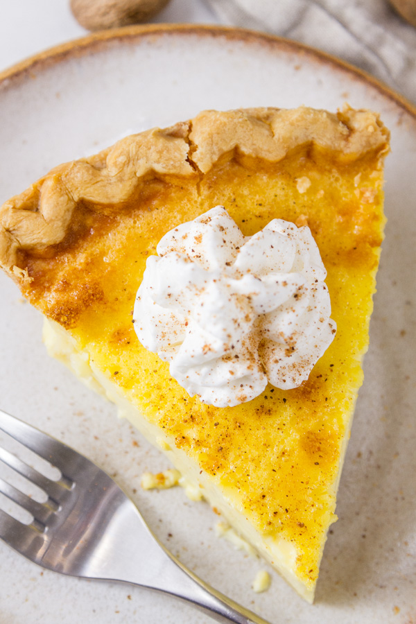 top down on a slice of pie with whipped cream
