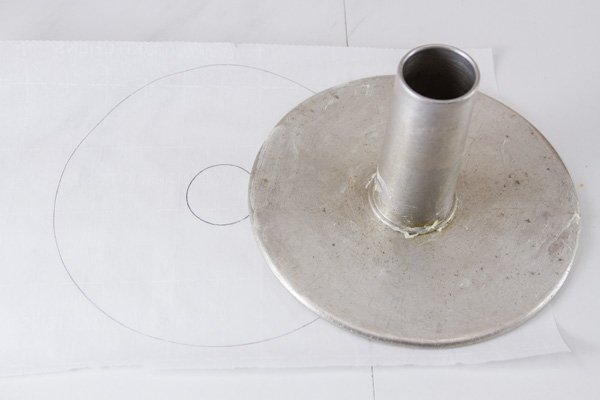 drawing the circles to cut out the parchment paper to line the pan to bake the cake