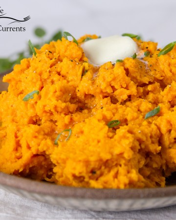 square crop: featured image sweet potatoes mashed on a plate with apat of butter and the Life Currents logo