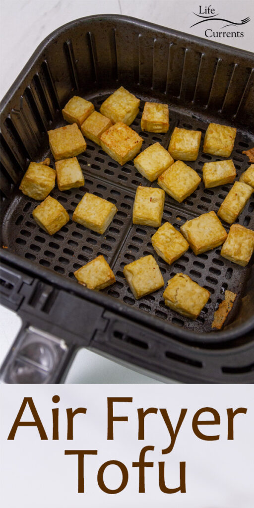cubed tofu in a basket of an air fryer, title on bottom: Air Fryer Tofu.