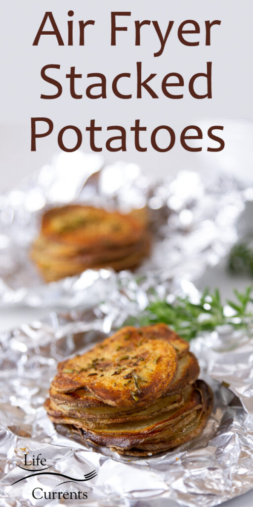 stacks of sliced and roasted potatoes in aluminum foil with fresh roasemary, title on top of image: Air Fryer Stacked Potatoes