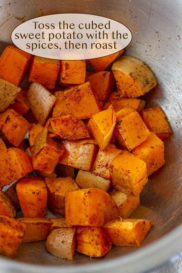 cubed sweet potatoes with spices in a bowl.