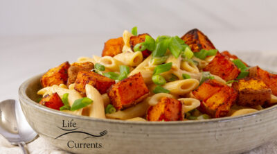 square crop of pasta served with roasted sweet potatoes.