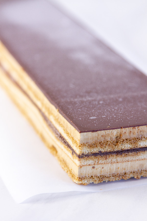 Opera cake with layers of cake and filling showing.