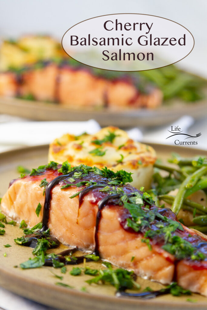 Cherry Balsamic Glazed Salmon on plate with potatoes au gration and green beans, title on top.