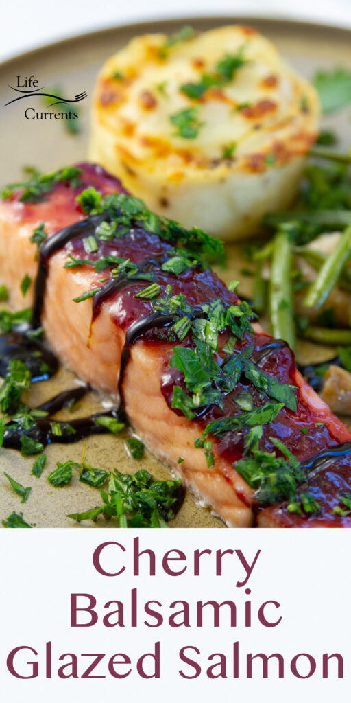 close up on glazed salmon with cherry and balsamic served with potatoes and green beans, title on bottom.