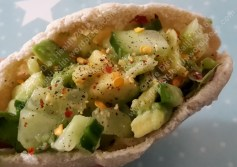 Add some salad and avocado to a houmous stuffed pitta