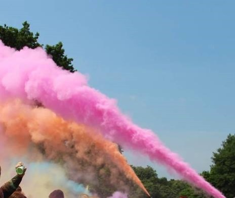 Colour paint being blasted in the air.