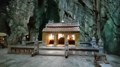 A stone shrine inside the largest cave in Marble Mountains
