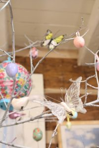 Glittery white butterfly on an Easter tree
