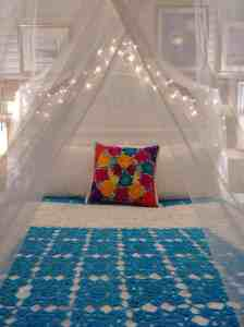 canopy and white lights on a bed