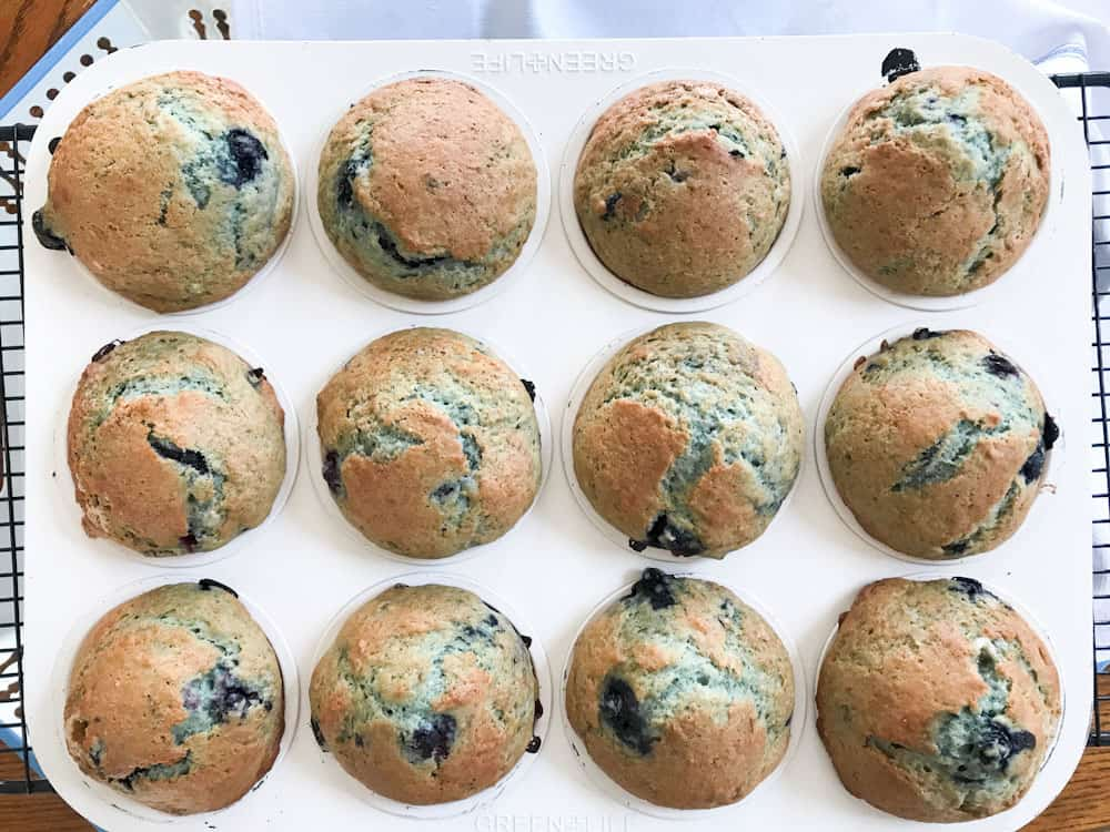 Life Full and Frugal / overhead view of blueberry muffins in a muffin tin on a cooling rack