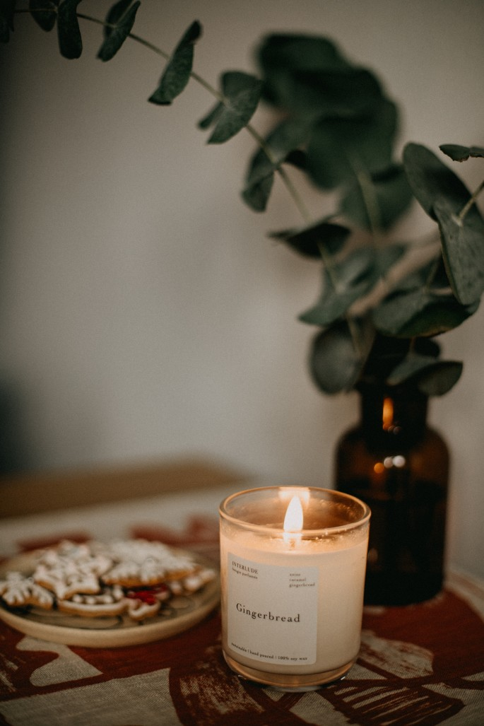 Candle lit for self-care ritual ambiance