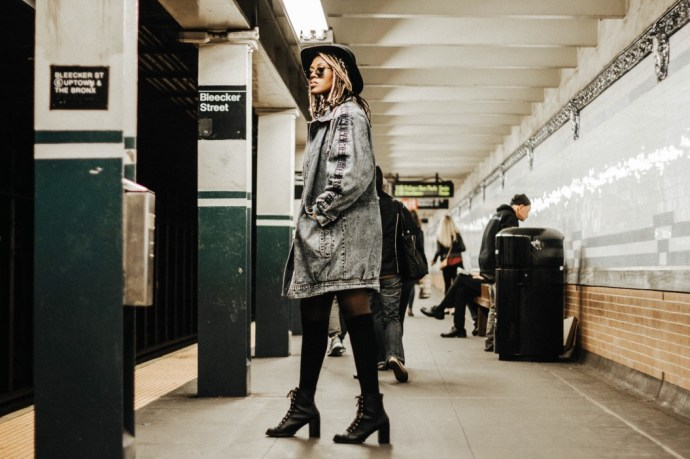 girl in new york city getting on train