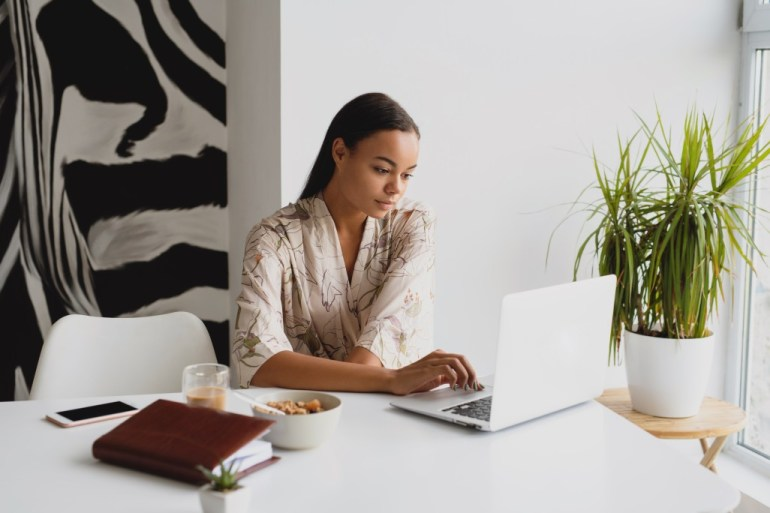 Black woman focusing during her work day