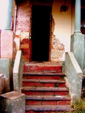 Stairs into an old unkept house