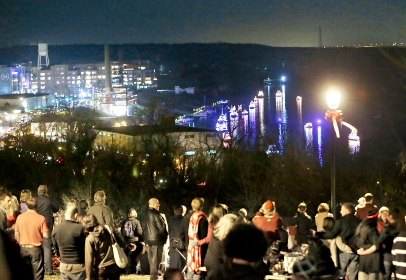 People view the Parade of Lights on the James River from Libby Hill Park Photo Credit