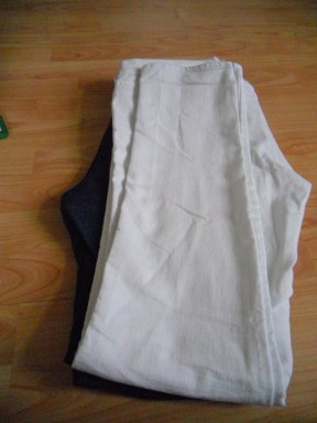 1: Lay pants on ground and fold in half