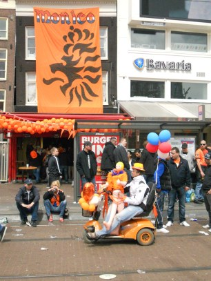 A man with a blow-up Queen Beatrix doll...