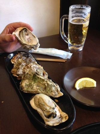 huge oysters for lunch on Miyajima Island, Japan
