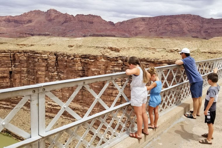People overlooking the grand canyon.