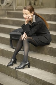 Disappointed woman on courthouse steps