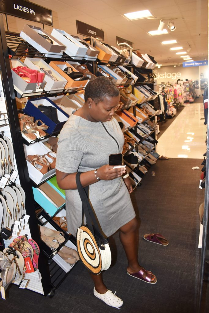 African American woman trying on Kate spade sale shoes Macys backstage