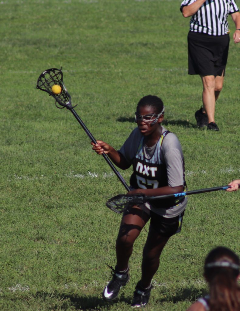 Brown Skin Girl Playing Lacrosse