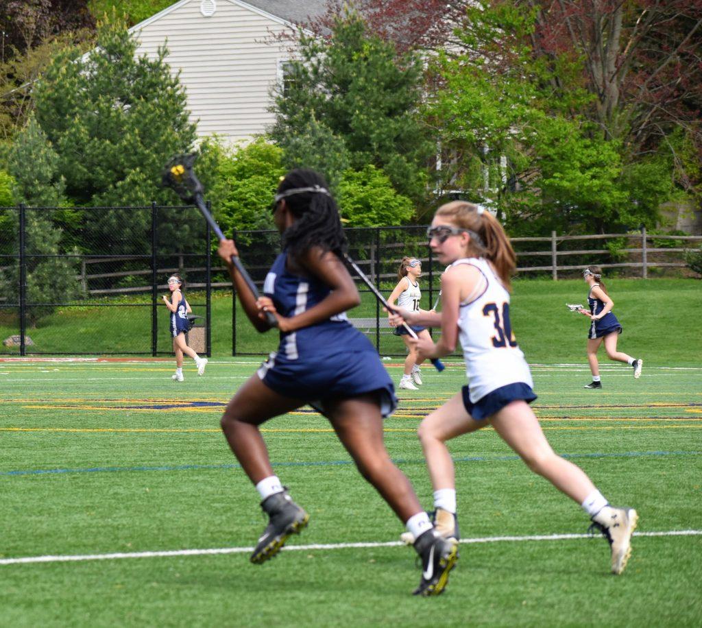 Brown girl of lacrosse.