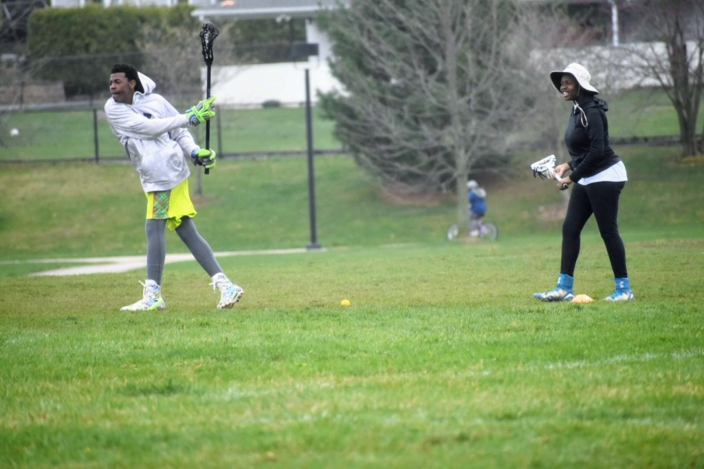 African American Kids playing Lacrosse