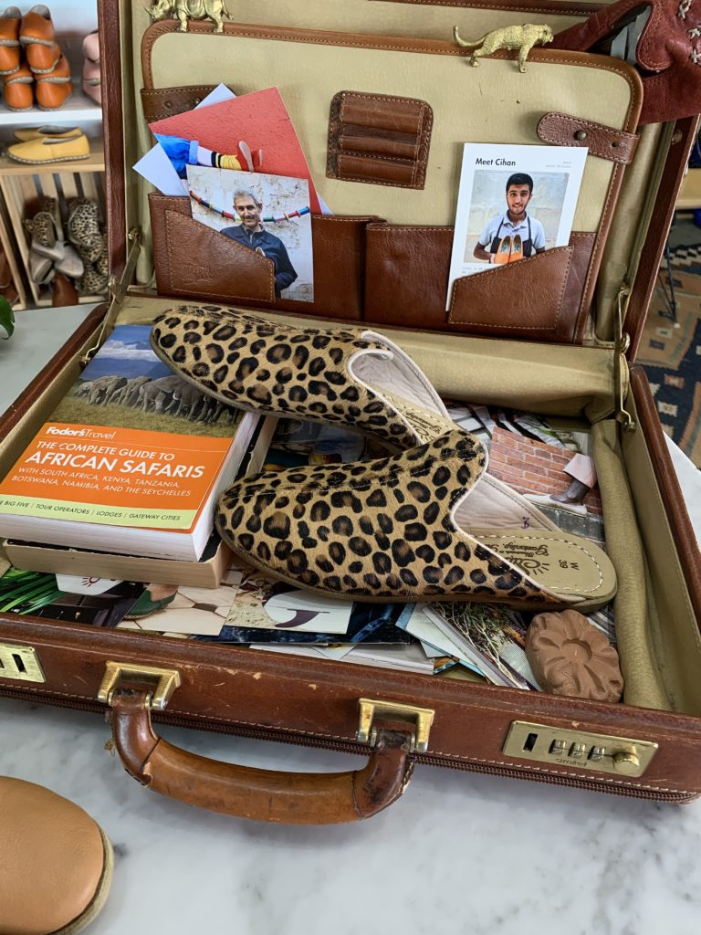 open suitcase with Sabah shoes from union market DC